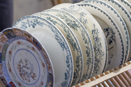 reusing: old plates displayed for sale at second hand shop Stock Photo