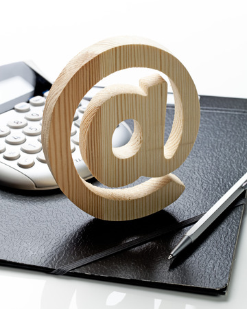 e market: concept of emailing strategy and cost with calculator and office supply on white background