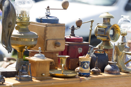 flea market: Antique coffee makers in display at flea market