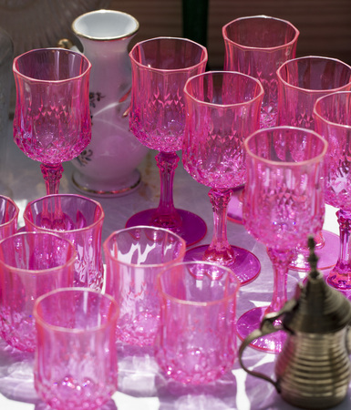 reusing: Antique pink glasses at flea market in the summer Stock Photo