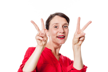 approving: satisfaction concept - playful 30s woman with two v victory signs approving, congratulating for optimism, white background studio