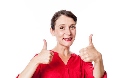 two thumbs up: satisfaction concept - cheerful 30s woman with two thumbs up approving, congratulating for success, white background studio