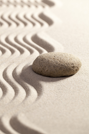 waves  pebble: sinuous path in zen sand for philosophy of life with one round stone or pebble set on the border waves Stock Photo