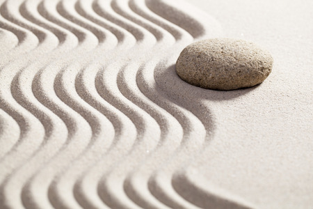 waves  pebble: sinuous path in zen sand for philosophy of life with one round pebble or stone set on the border waves Stock Photo