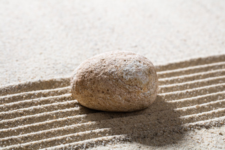 tranquillity: zen sand still-life - textured pebble on straight lines for concept of concentration or tranquillity