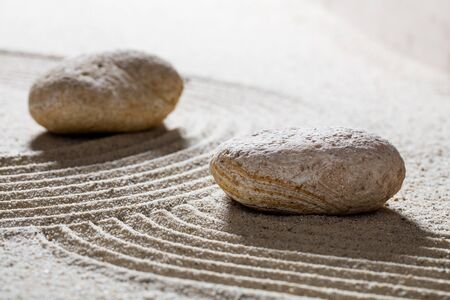 inner peace: zen sand still-life - textured pebbles and sinuous waves for concept of beauty spa or spirituality with inner peace