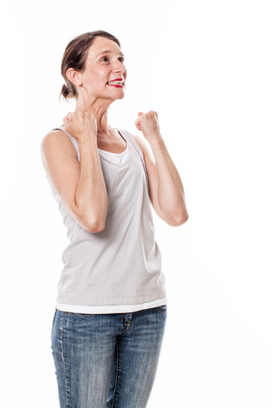 winning concept: winning concept - thrilled young woman gesturing, standing for fun victory and wellbeing, white background Stock Photo