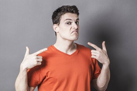 accuse: guilt concept - unhappy young sporty man showing his throat with gun-like hands for sign of low self-esteem, textured effects Stock Photo