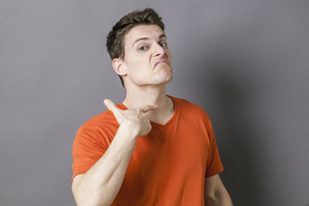 guilt: guilt concept - mad young sportsman showing his throat with gun-like hand for sign of victim or suicide, green effects