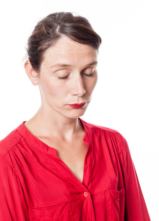 lethargy: lethargy and apathy - portrait of a tired young woman with red shirt standing with eyes closed sleeping over white background Stock Photo