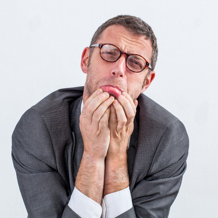 pouting: portrait of burnout - pouting middle aged businessman begging to avoid stress, nervousness and anxiety, isolated white background
