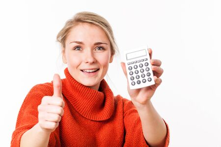 approving: successful savings - thrilled young blond woman approving positive savings as financial entrepreneur with thumbs up, isolated over white background