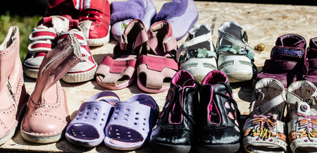 reusing: display of used child and baby girl shoes for reusing,reselling,charity,donating or thrift store for second life sold at flea market at springtime