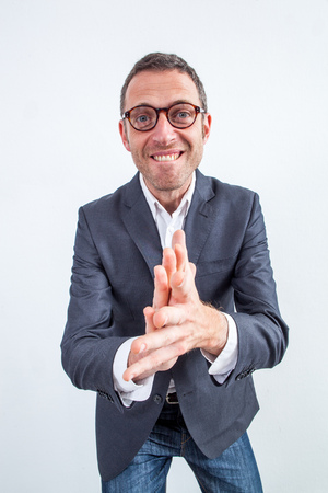 sarcastic: sarcastic bearded middle aged businessman clapping his hands in the foreground for bullying revenge or success at work, wide angle view over white background Stock Photo