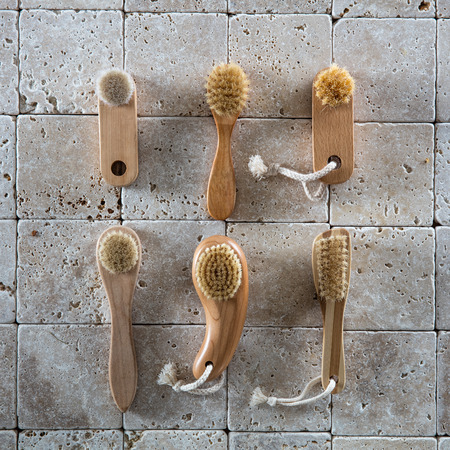 footcare: collection of complexion brush, nail brush and footcare brush set on pure limestone background for dry brushing body care wallpaper, flat lay Stock Photo