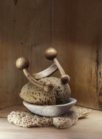 turkish bath: Sauna, hammam or Turkish bath wooden background with loofah mitt, natural sponge and wood massage accessory for organic wellness