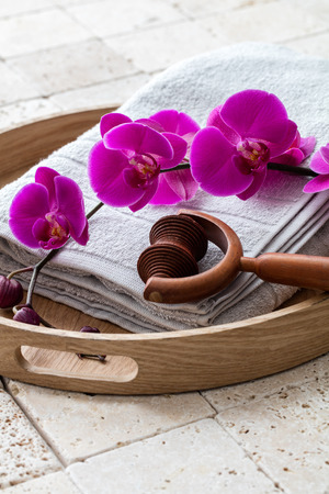 concept of relaxation and washing up at the spa after calming shower or bath over symbol of massage and femininity