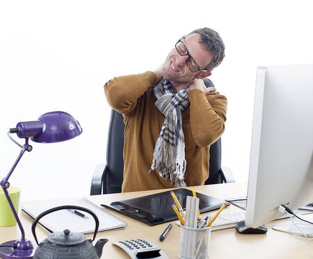 sick middle aged male entrepreneur or independent man suffering from sore neck or headache, relaxing tension and pressure in shoulders from painful business hours at his desk, white background Stock Photo