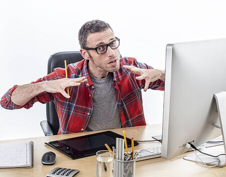 tensed: tensed casual entrepreneur with eyeglasses expressing his frustration and exasperation with nervous hands at his graphic designer desk, white background