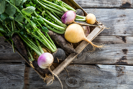 lay flat of fresh green vegetables imperfect with roots in crate on old wood background for authentic sustainable harvest, studio shot Фото со стока - 67741134