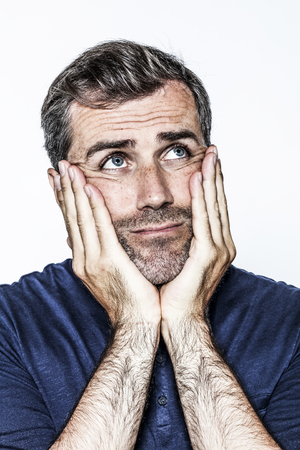 circumspect: contemplative body language for thinking middle aged handsome bearded man looking up for critical solution, white background studio