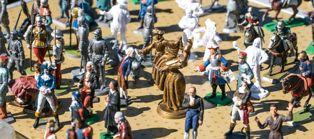 resale: group of classic hand painted French Revolution and old knight lead figurines for History or childhood memories at garage sale, Europe, outdoors