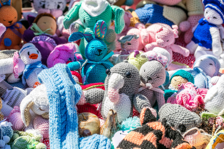 group of crochet soft fabric toys, hand made by grand mother for cool baby or kid collections from garage sale or charity outdoor