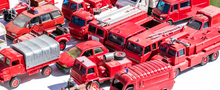 collector display for metallic firefighter truck and red car specialists at garage sale, flea market or boot sale, Europe, outdoors Stock Photo
