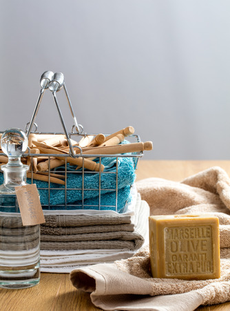 green DIY laundry ingredients to wash fabric and get soft nontoxic towels with biodegradable Marseille olive oil soap and vinegar, allergy free clothing