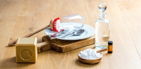 making homemade dish washing detergent with healthy soap, natural essential oils and biodegradable baking soda for DIY green cleaning