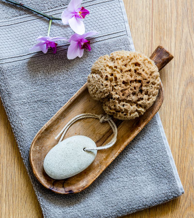 traditional beauty and body care objects with orchid flowers over grey towel for minimalist home spa and healthy bath, top view Фото со стока