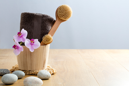 Pamper, exfoliate, wash up, cleanse, dry brush, detox for zen wellbeing and natural sensuality at the spa. Copy space with stones and orchids Фото со стока