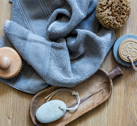 natural grey towel with body brush, rustic footcare accessory and traditional soap for zero waste shower, top view