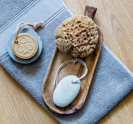 ethnic solid soap, footcare object and natural sponge for home beauty spa, healthy body care and shower, above view Фото со стока