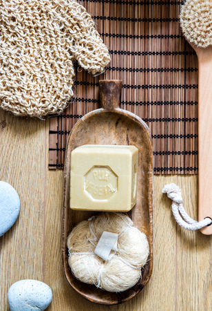 loofah, dry brush and traditional olive oil solid soap for minimalist body care, massage and healthy zero waste hygiene, top view Фото со стока