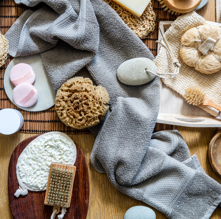 still life with many healthy body care and skincare objects - natural sponge, loofah, body and manicure brushes for traditional green beauty, top view Фото со стока