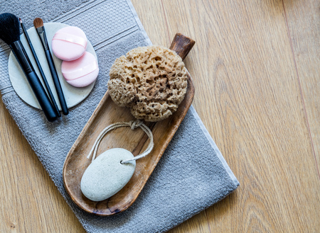 clean makeup brushes, footcare object and natural sponge for home beauty spa, exfoliation and healthy shower, top view