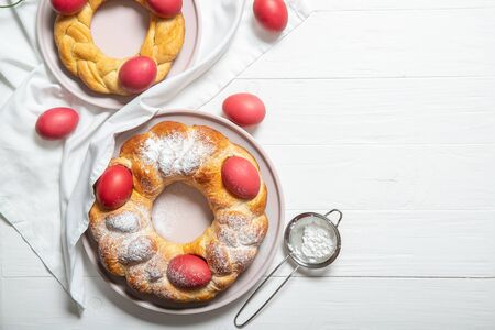 Tasty easter bread. Easter bread and red eggs. Italian easter bread