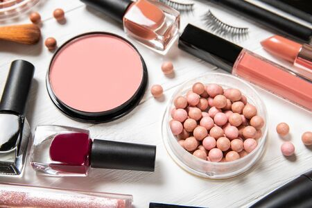 Set of decorative cosmetics on a light background. Stock fotó