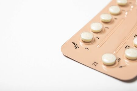 Female oral contraceptive pill blister on a white background background