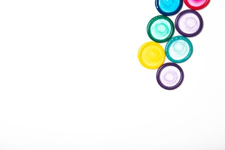 Colored condoms isolated on a white background. Contraception. Place for text