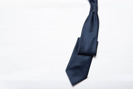 Men's tie on a white wooden background. Place for text Stok Fotoğraf