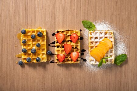 Delicious Belgian waffles with fresh fruits. View from above
