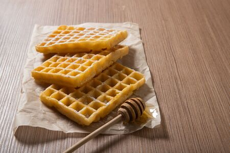 Delicious Belgian waffles with honey. Bakery products. Food