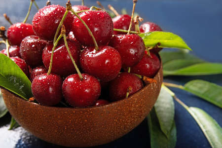 Tasty juicy cherries on a plate. Drops of water on a cherry. Close-up