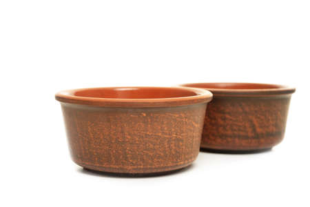 Brown ceramic bowl isolated on white background