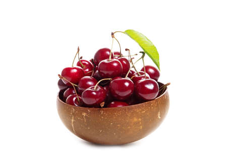 Plate with sweet cherries isolated on a white background Stok Fotoğraf