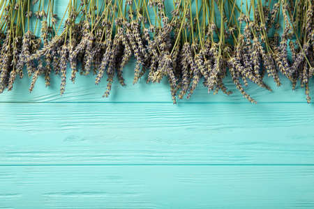 Lavender flowers on a blue wooden background. Place for text. View from above