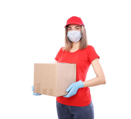 Home delivery, online order. Female courier in a medical mask and rubber gloves with a box, with a parcel in her hands. Food delivery during the quarantine coronavirus pandemic