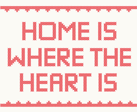 Cross stitch text with decorative border Home is Where The Heart is Illustration